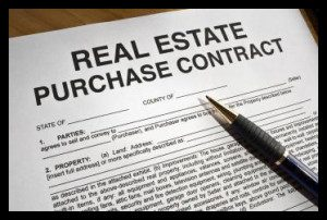 The American Dream? A real estate purchase contract with a pen for signing.