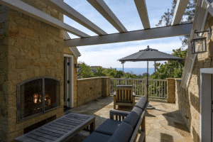 Terrace with fireplace and seating showing the Santa Barbara Lifestyle