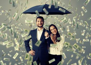 smiley successful couple with umbrella standing under money rain top show the importance of your portfolio