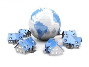 world with houses surrounding it to show think globally in real estate