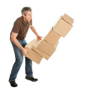 Man dropping boxes to show tips for stress free move for every member of the family