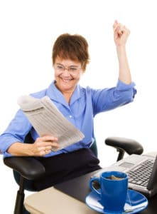 Businesswoman happy about the latest capital gains tax news.  Isolated on white.
