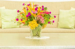 vase of Various types of flowers in modern Cream living room - staging a home