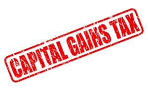 CAPITAL GAINS TAX red stamp text on white