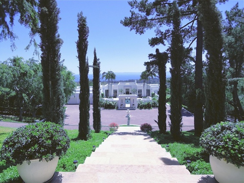 One of several Montecito estates listed by Cristal Clarke. White Neo-classical-Modernist home overlooking the Pacific Ocean