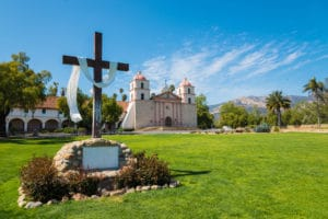 Mission Santa Barbara in Santa Barbara, California with a cross and a sky blue background to illustrate Easter in Santa Barbara 2019