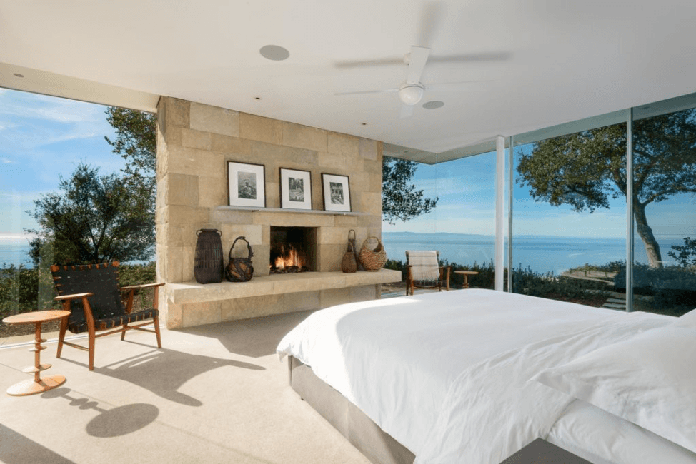 Master bedroom with lovely fire burning in fire place