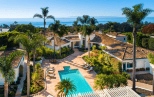 Another Montecito home for sale. Image taken from a bird's eye view with palm trees and pool as the major focal points