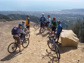 Participants of the mountain to the shore bike ride stopping to catch a breathtaking view of Santa Barbara.