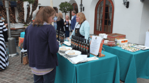 customer in front f table for complimentary olive oil tasting in rancho oilivos