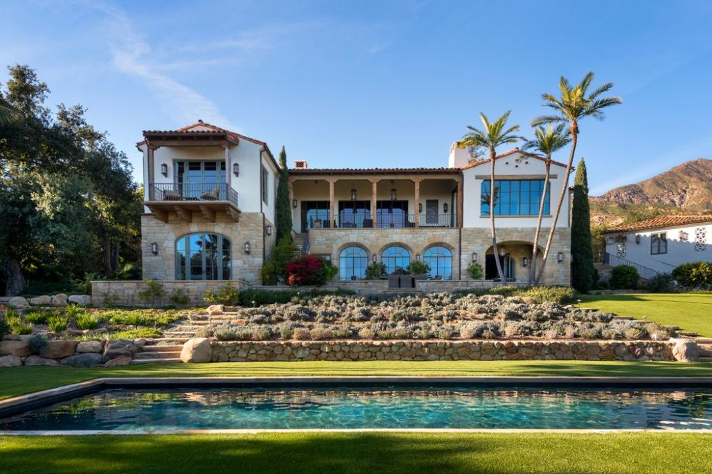 A Don Nulty-Designed Spanish Masterpiece, a prime example of the red-tile clay roofs, white stucco walls, and wood-beam ceilings that have become synonymous with Santa Barbara architecture.