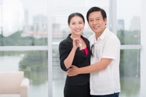 Portrait of a mid-aged Vietnamese couple in their new house