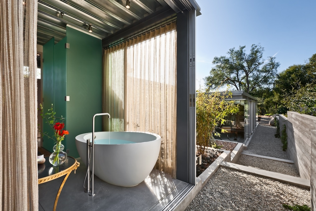 This Montecito Residence by Barton Myers Associates has an amazing updated bathroom with a soaking tub to die for!