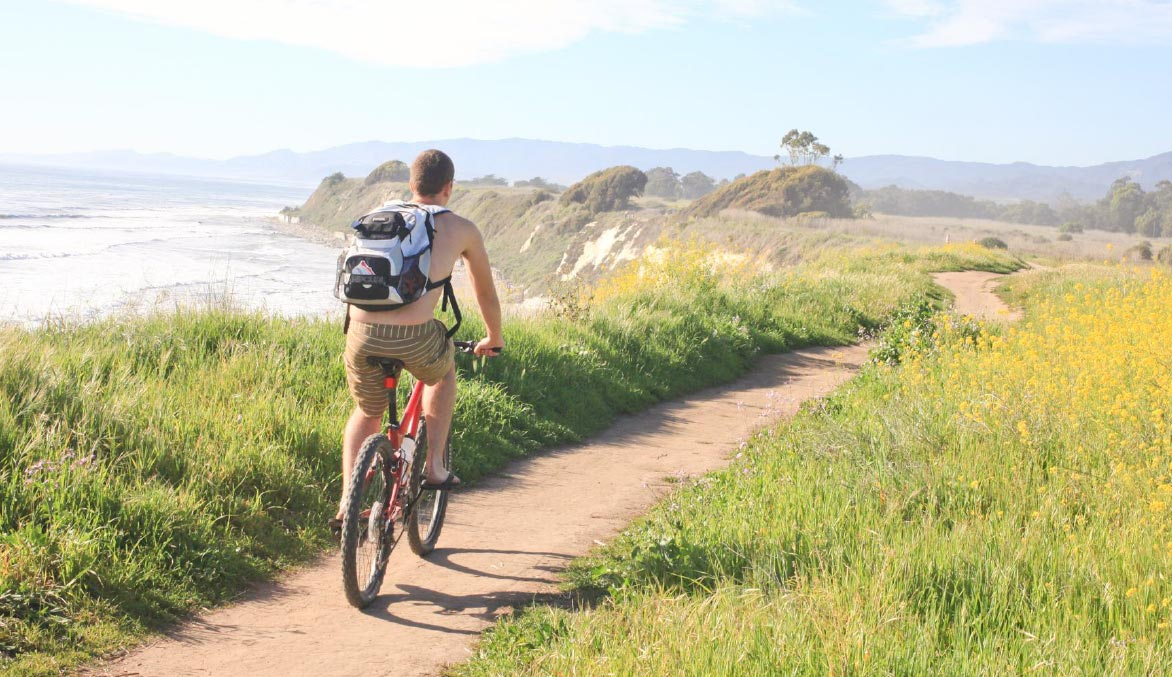 Man riding a bike along the california coast