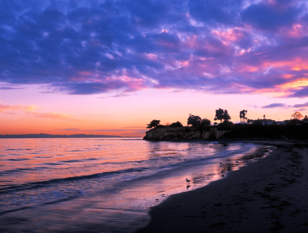 Beautiful beach sunset filled wiht purle and pink sky over the ocean in Santa Barbara