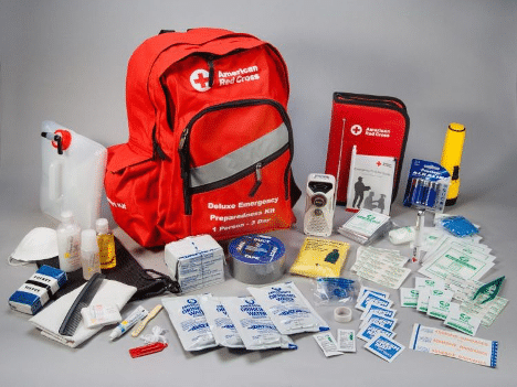 An official Red Cross Disaster Preparedness Kit with all the items needed surrounding it