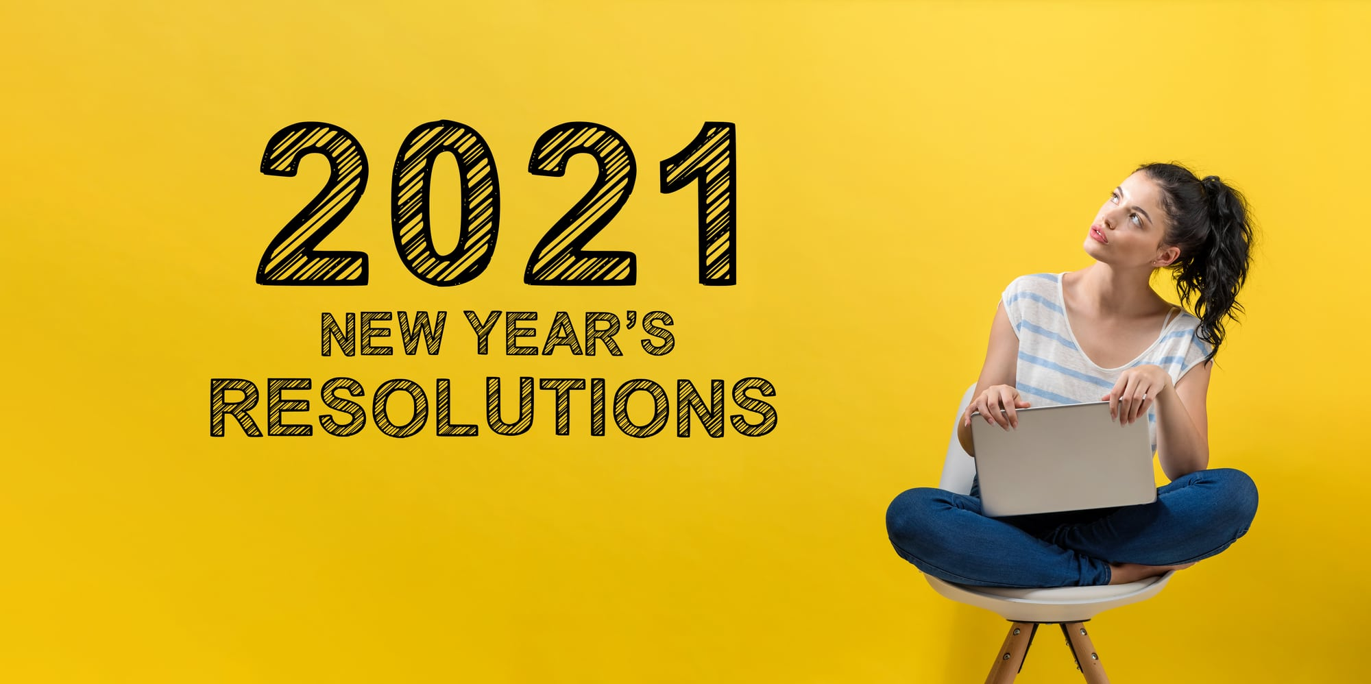 2021 New Years Resolutions with young woman using a laptop computer